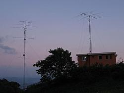 80m dipole is visible hanging between the towers.  Big tower also has 160m sloper facing NE @ 120ft.  NE and SE Beverages are al
